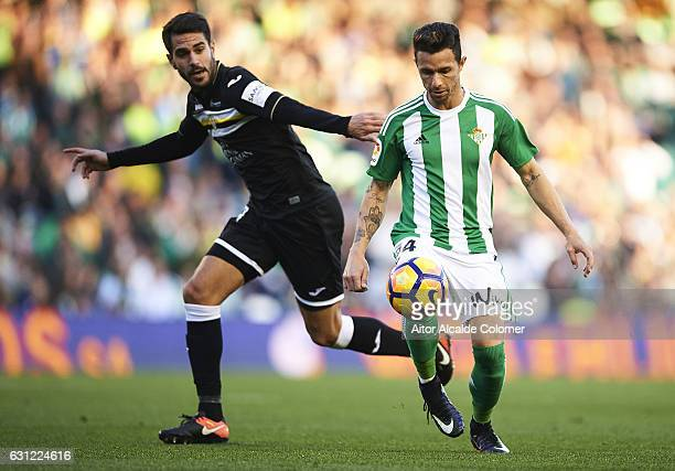 Ruben Castro of Real Betis Balompie being followed by Pablo Insua of CD Leganes during La Liga match between Real Betis Balompie v CD Leganes at...