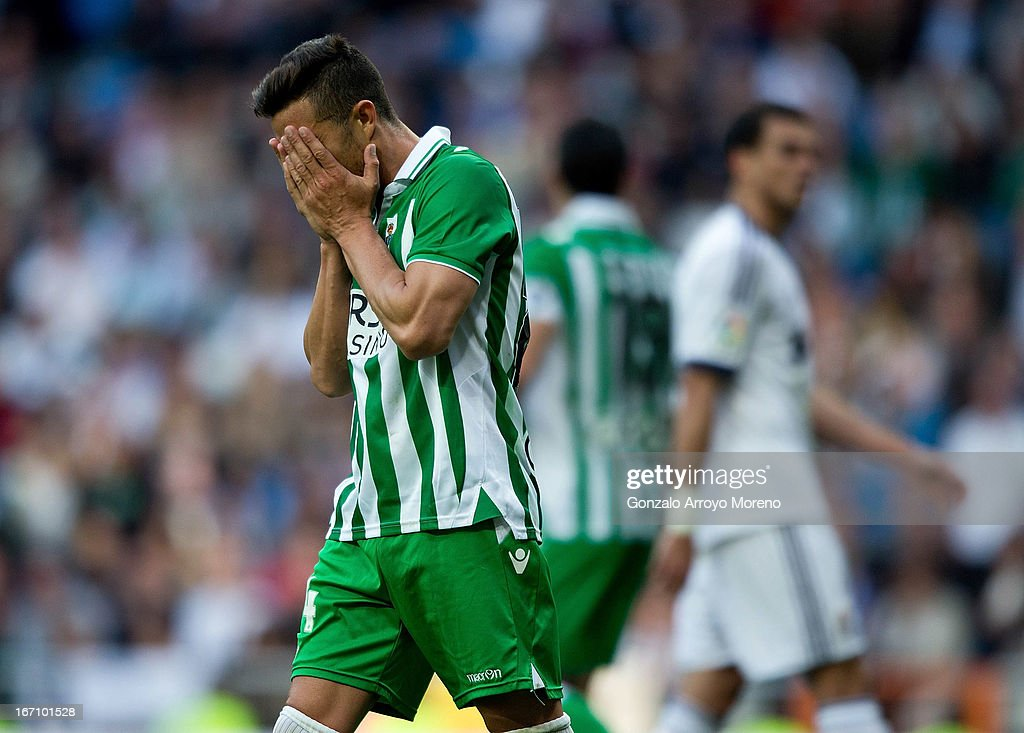 Ruben Castro of Real Betis Balompie reacts defeated close to the end of the La Liga match between Real Madrid CF and Real Betis Balompie at Santiago...