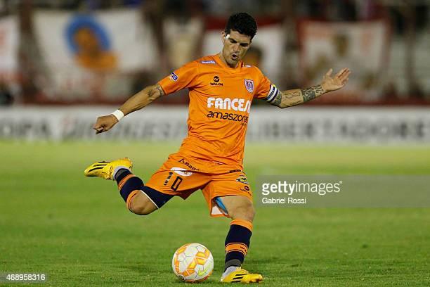 Ruben Cuesta of Universitario Sucre kicks the ball during a match between Huracan and Universitario Sucre as part of Group 3 of Copa Bridegestone...