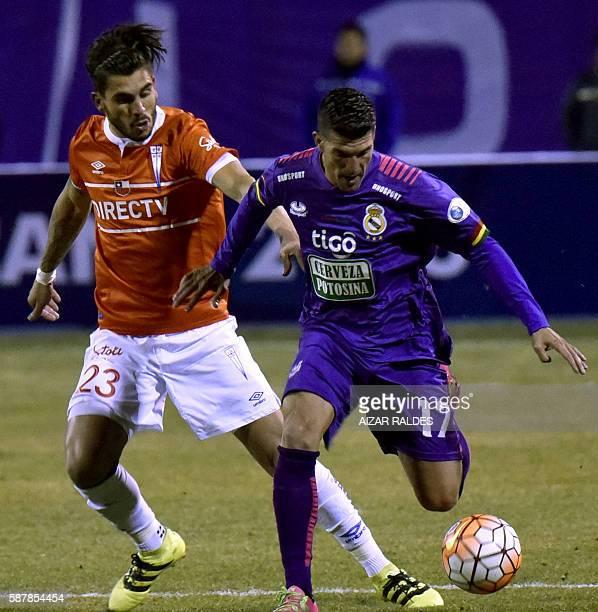 Ruben de la Cuesta of Bolivia's Real Potosi vies for the ball with Enzo Kaliski of U Catolica of Chile during their Copa Sudamericana football match...