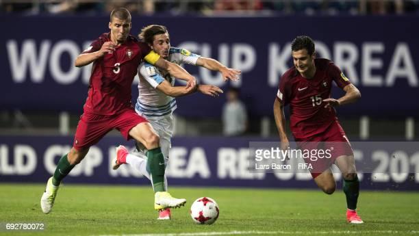 Ruben Dias of Portugal and Diogo Dalot of Portugal challenges Matias Vina of Uruguay during the FIFA U20 World Cup Korea Republic 2017 Quarter Final...