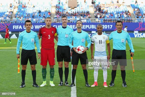 Ruben Dias of Portugal and Nicolas de la Cruz of Uruguay pose for a photograph with match officials prior to the FIFA U20 World Cup Korea Republic...