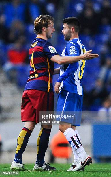 Ruben Duarte argues with Ivan Rakitic of FC Barcelona during the Copa del Rey Round of 16 second leg match between RCD Espanyol and FC Barcelona at...