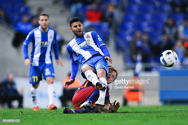Ruben Duarte of RCD Espanyol is brought down by Ivan Rakitic of FC Barcelona during the Copa del Rey Round of 16 second leg match between RCD...