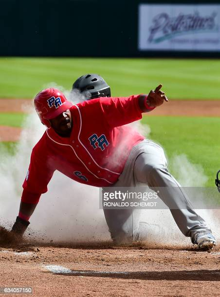 Ruben Gotay of Criollos de Caguas of Puerto Rico slides safe in home during a Caribbean Baseball Series match against Aguilas del Zulia of Venezuela...