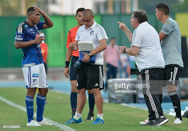 Ruben Israel coach of Millonarios gives directions to his player Elkin Blanco during a match between Alianza Petrolera and Millonarios as part of...