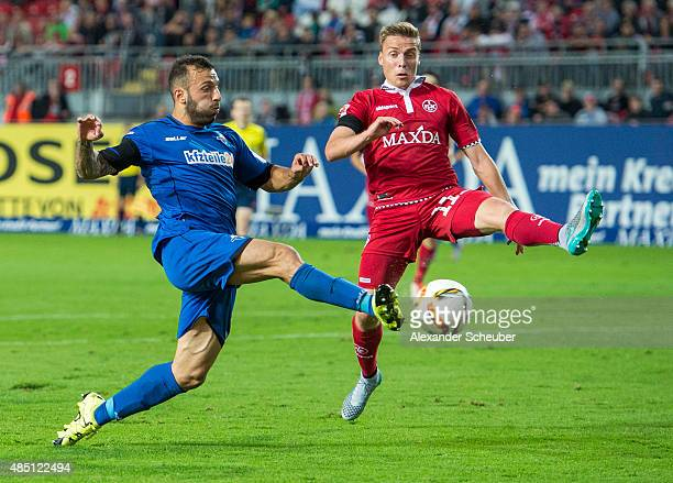 Ruben Jenssen of 1 FC Kaiserslautern challenges Sueleyman Koc of SC Paderborn during the second Bundesliga match between 1 FC Kaiserslautern and SC...