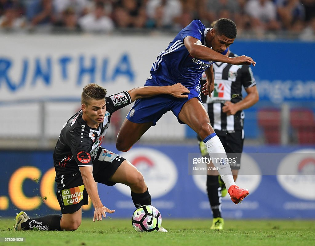 Ruben Loftus Cheek of Chelsea and Augustin of WAC RZ Pellets battle for the ball during the pre season friendly match between WAC RZ Pellets and Chelsea FC at the Worthersee Stadion on July 20, 2016 in Klagenfurt, Austria.