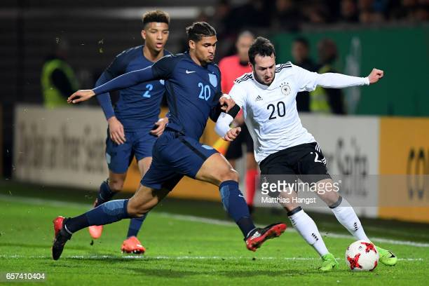 Ruben Loftus Cheek of England challenges Levin Oeztunali of Germany during the U21 international friendly match between Germany and England at...