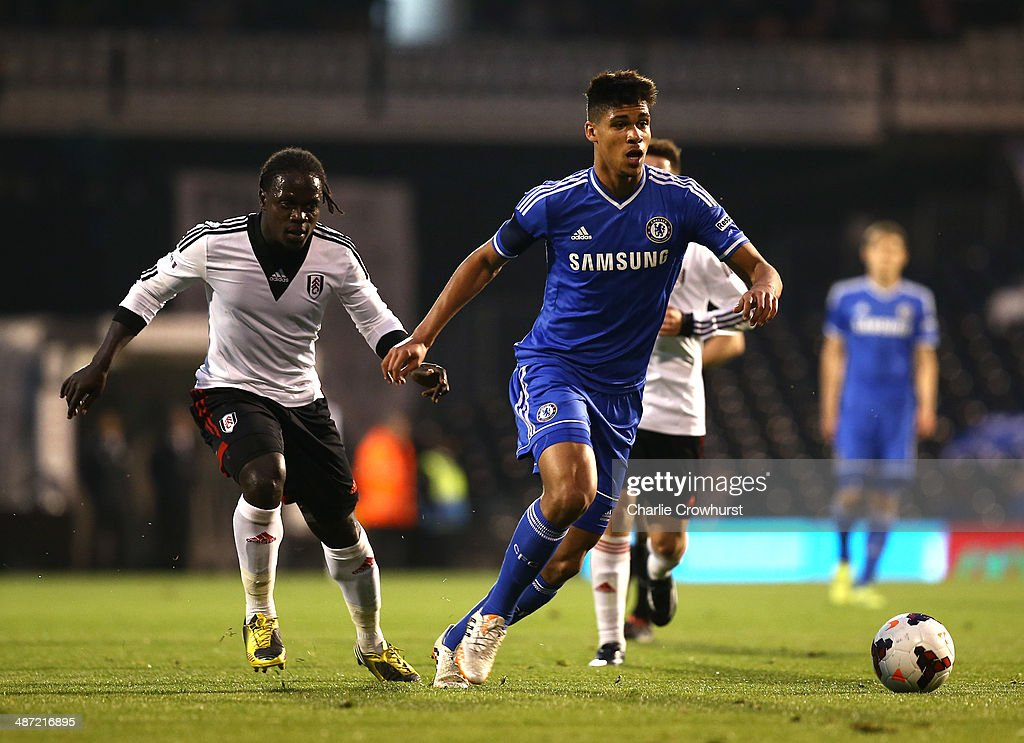 Ruben Loftus-Cheek of Chelsea holds off Fulham's Solomon Sambou during the FA Youth Cup Final: First Leg match between Fulham and Chelsea at Craven Cottage on April 28, 2014 in London, England.