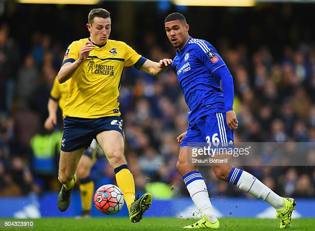 Ruben LoftusCheek of Chelsea holds off Murray Wallace of Scunthorpe United during the Emirates FA Cup third round match between Chelsea and...