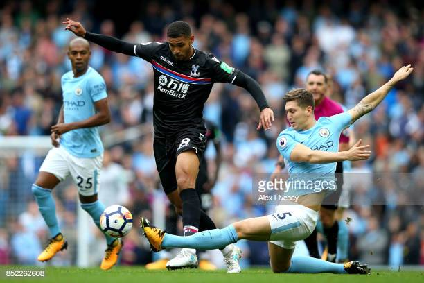 Ruben LoftusCheek of Crystal Palace and John Stones of Manchester City compete for the ball during the Premier League match between Manchester City...