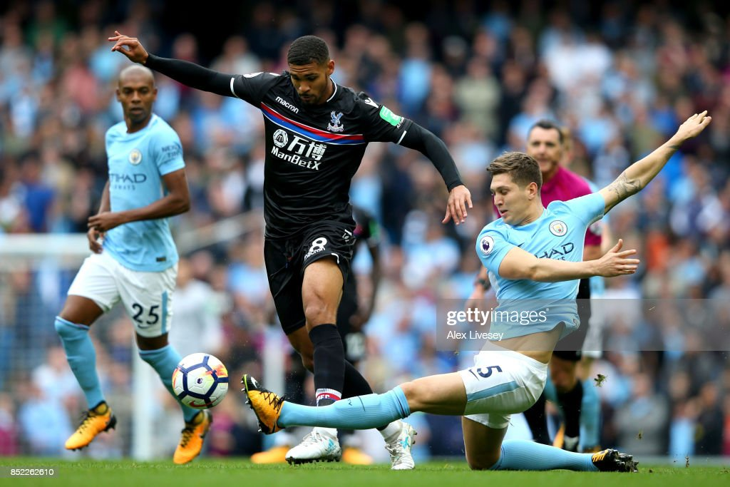 Ruben Loftus-Cheek of Crystal Palace and John Stones of Manchester City compete for the ball during the Premier League match between Manchester City and Crystal Palace at Etihad Stadium on September 23, 2017 in Manchester, England.