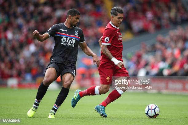 Ruben LoftusCheek of Crystal Palace and Roberto Firmino of Liverpool during the Premier League match between Liverpool and Crystal Palace at Anfield...