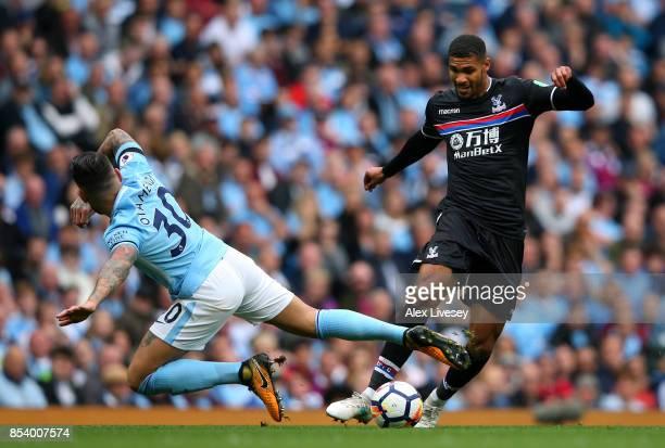 Ruben LoftusCheek of Crystal Palace beats Nicolas Otamendi of Manchester City during the Premier League match between Manchester City and Crystal...