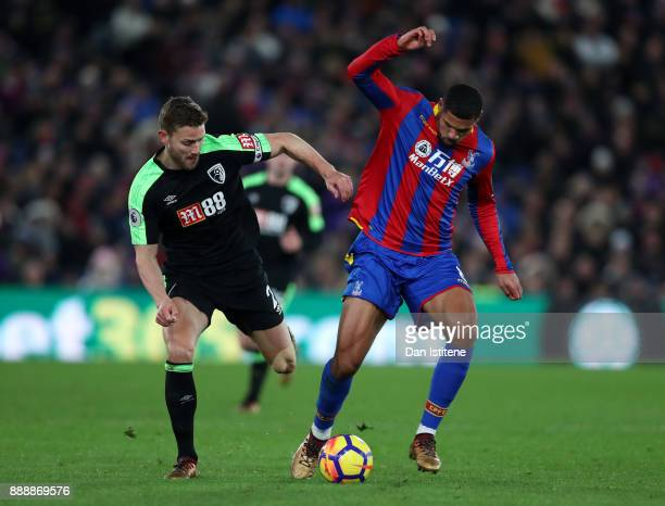 Ruben LoftusCheek of Crystal Palace is challenged by Simon Francis of AFC Bournemouth during the Premier League match between Crystal Palace and AFC...