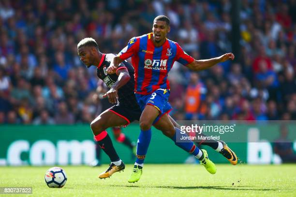 Ruben LoftusCheek of Crystal Palace tackles Steve Mounie of Huddersfield Town during the Premier League match between Crystal Palace and Huddersfield...