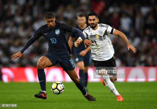 Ruben LoftusCheek of England and IIkay Gundogan of Germany battle for possession during the International friendly match between England and Germany...