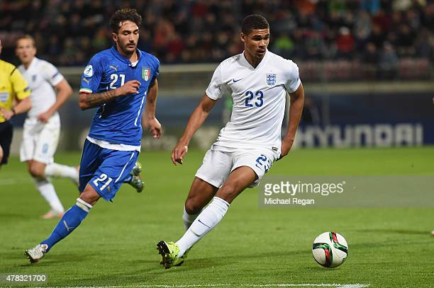Ruben LoftusCheek of England in action with Danilo Cataldi of Italy during the UEFA Under21 European Championship match between England and Italy at...
