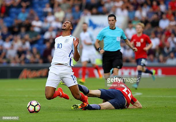 Ruben LoftusCheek of England is tackled by Ole Selnaes of Noway during the European Under 21 Qualifier match between England U21 V Norway U21 at...