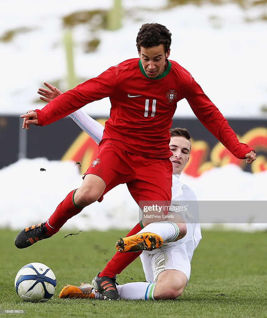 Ruben Macedo of Portugal is tackled by Jon Gorenc Stankovic of Slovenia during the UEFA European Under-17 Championship Elite Round match between Slovenia and Portugal at St George's Park on March 25, 2013 in Burton-upon-Trent, England.
