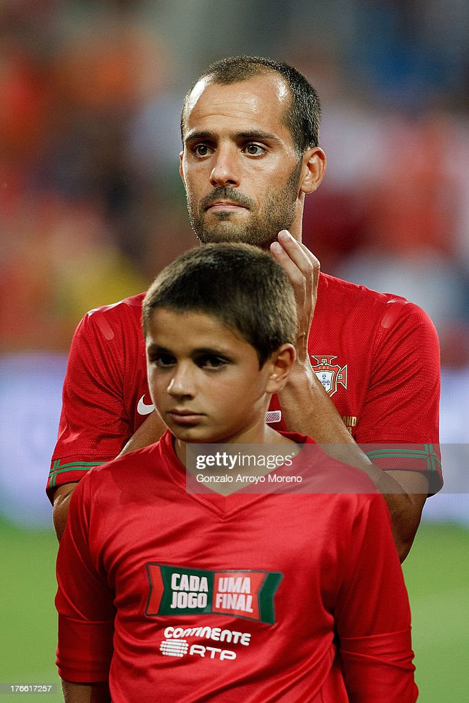 <a gi-track='captionPersonalityLinkClicked' href=/galleries/search?phrase=Ruben+Micael&family=editorial&specificpeople=5848979 ng-click='$event.stopPropagation()'>Ruben Micael</a> of Portugal claps after singing the Portuguese nathional anthem prior to start the International Friendly match between Portugal and Netherlands at Estadio Algarve on August 14, 2013 in Faro, Portugal.