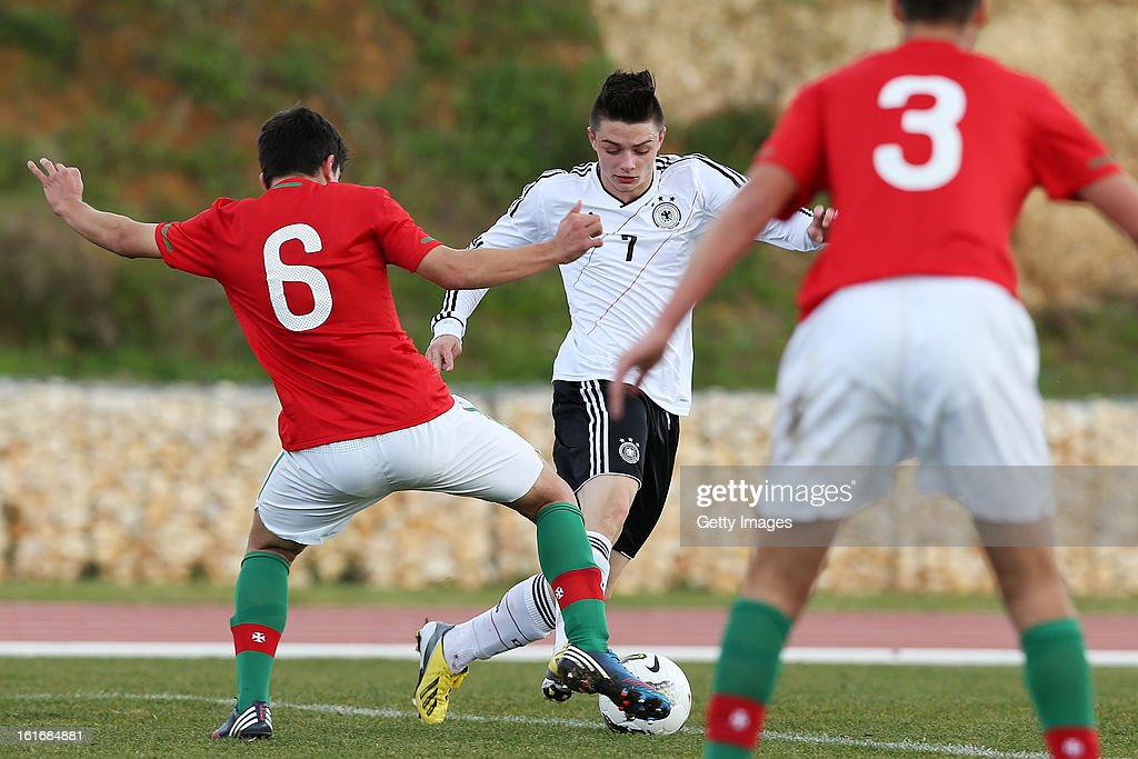 Ruben Neves (L) of Portugal challenges Maurice Multhaup of Germany during the Under17 Algarve Youth Cup match between U17 Portugal and U17 Germany at the Stadium Bela Vista on February 12, 2013 in Parchal, Portugal.