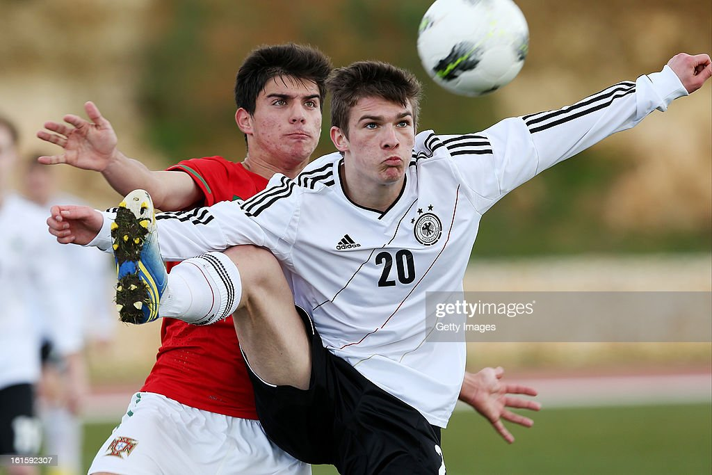 Ruben Neves of Portugal challenges Tim Dierben of Germany during the Under17 Algarve Youth Cup match between U17 Portugal and U17 Germany at the Stadium Bela Vista on February 12, 2013 in Parchal, Portugal.