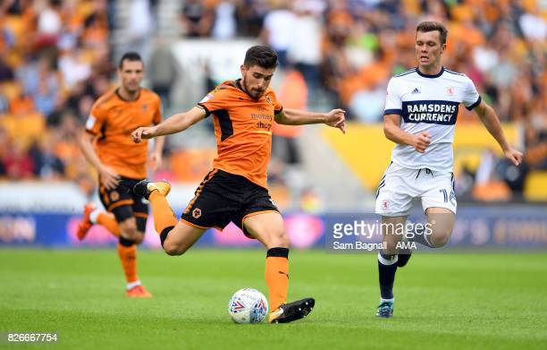 Ruben Neves of Wolverhampton Wanderers and Jonny Howson of Middlesborough during the Sky Bet Championship match between Wolverhampton and...