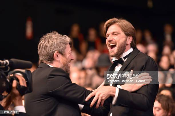 Ruben Ostlund celebrates after winning the Palme d'Or for the movie 'The Square' during the Closing Ceremony during the 70th annual Cannes Film...