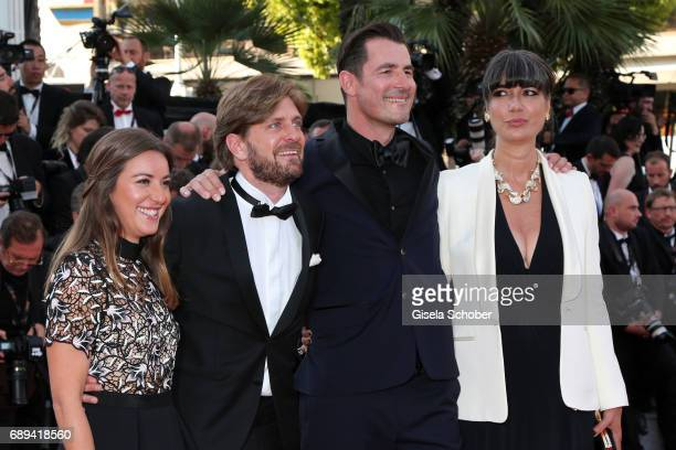 Ruben Ostlund Claes Bang and his wife Lis Kasper Bang attend the Closing Ceremony of the 70th annual Cannes Film Festival at Palais des Festivals on...