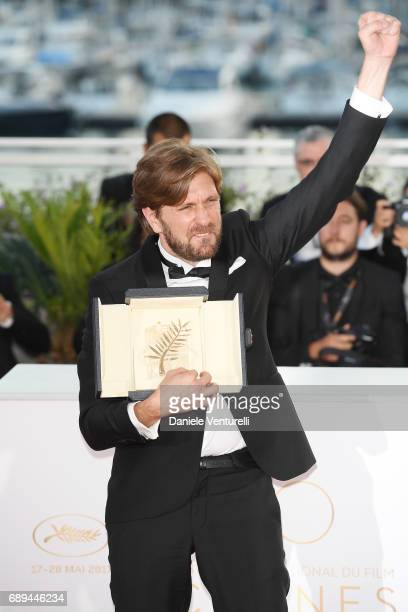 Ruben Ostlund winner of the Palme d'Or for the movie 'The Square attends the Palme D'Or winner photocall during the 70th annual Cannes Film Festival...
