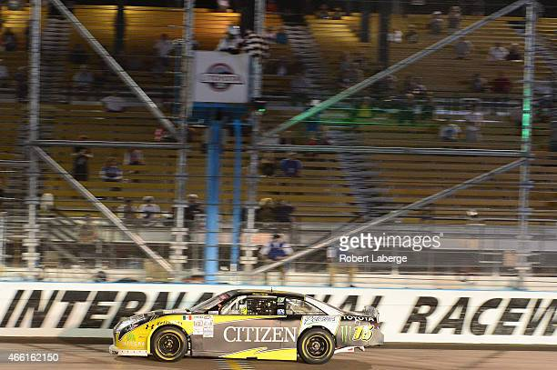Ruben Pardo driver of the CitizenPotosinos Toyota crosses the finish line to win the NASCAR Mexico Series Toyota 120 at Phoenix International Raceway...