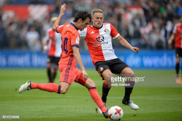 ROTTERDAM NETHERLANDS JULY Ruben Pardo from Real Sociedad is tackled by Jens Toornstra from Feyenoord during the friendly match between Feyenoord and...