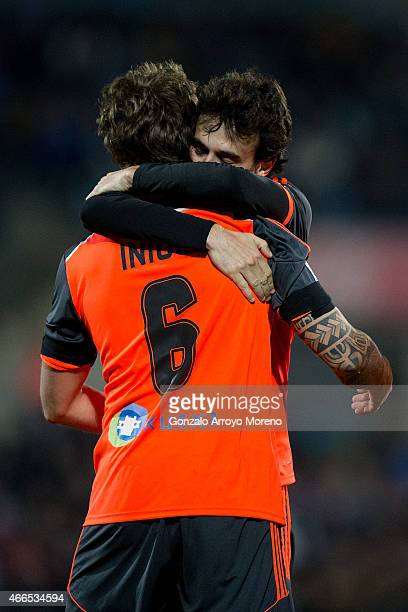 Ruben Pardo of Real Sociedad de Futbol embraces his tesammate Inigo Martinez celebrating his goal during the La Liga match between Getafe CF and Real...