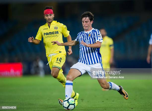 Ruben Pardo of Villarreal CF duels for the ball with Alvaro Odriozola of Real Sociedad during the La Liga match between Real Sociedad de Futbol and...
