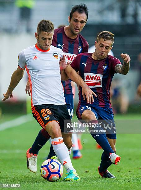 Ruben Pena of SD Eibar duels for the ball with Alvaro Medran of Valencia CF during the La Liga match between SD Eibar and Valencia CF at Ipurua...
