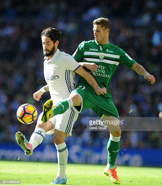 Ruben Perez of CD Leganes controls tackles Isco of Real Madrid during the Liga match between Real Madrid CF and Leganes on November 6 2016 in Madrid...