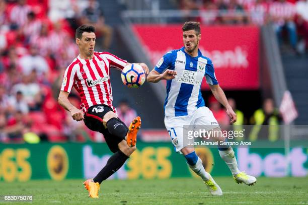 Ruben Perez of Club Deportivo Leganes competes for the ball with Aritz Aduriz of Athletic Club during the La Liga match between Athletic Club Bilbao...