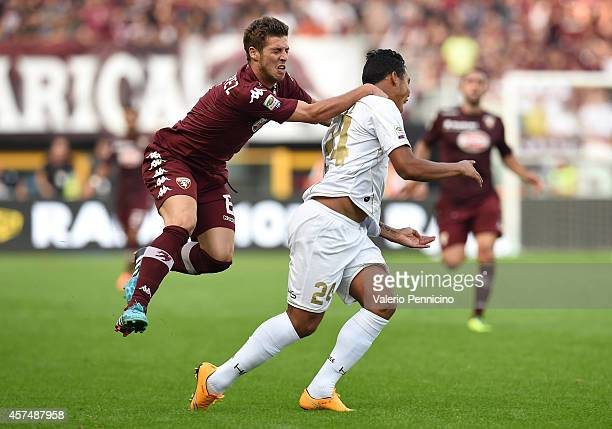 Ruben Perez of Torino FC tackles Luis Muriel of Udinese Calcio during the Serie A match between Torino FC and Udinese Calcio at Stadio Olimpico di...