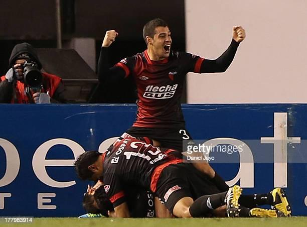 Ruben Ramirez of Colon celebrates with teammates after scoring during a soccer match between River Plate and Colon at Antonio Vespucio Liberti...