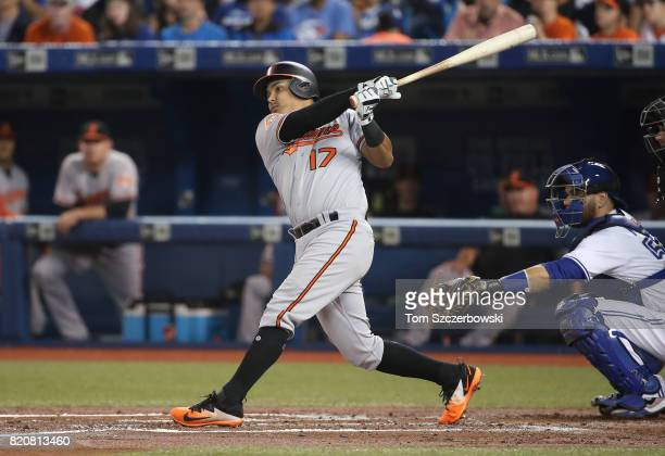 Ruben Tejada of the Baltimore Orioles hits a single in the third inning during MLB game action against the Toronto Blue Jays at Rogers Centre on June...