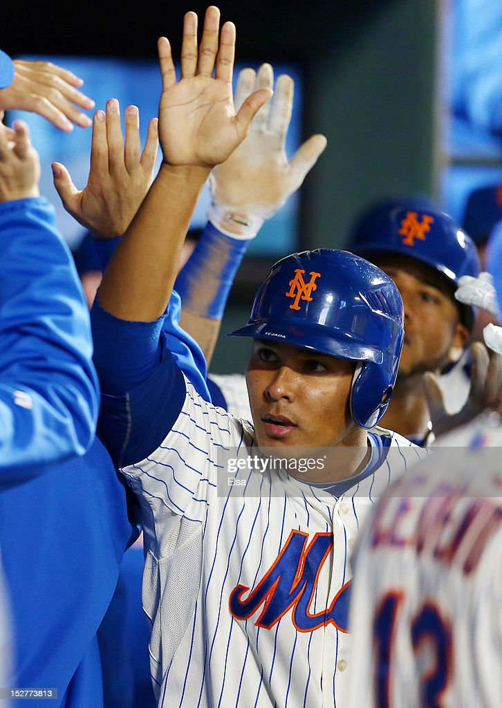 <a gi-track='captionPersonalityLinkClicked' href=/galleries/search?phrase=Ruben+Tejada&family=editorial&specificpeople=5754705 ng-click='$event.stopPropagation()'>Ruben Tejada</a> #11 of the New York Mets and teammate Jordany Valdespin #1 are congratulated in the dugout after they scored on a single by David Wright in the seventh inning against the Pittsburgh Pirates on September 25, 2012 at Citi Field in the Flushing neighborhood of the Queens borough of New York City.