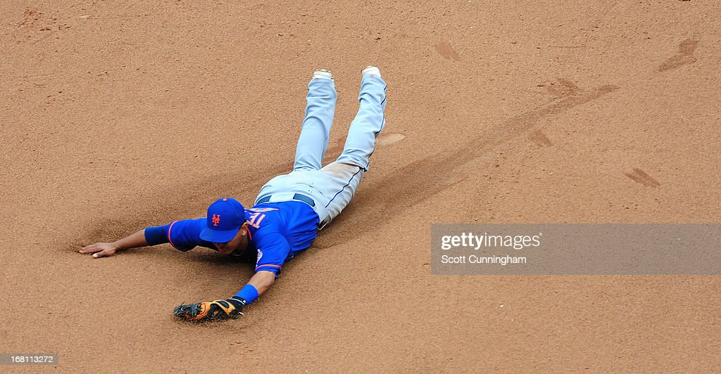 <a gi-track='captionPersonalityLinkClicked' href=/galleries/search?phrase=Ruben+Tejada&family=editorial&specificpeople=5754705 ng-click='$event.stopPropagation()'>Ruben Tejada</a> #11 of the New York Mets dives for a ground ball against the Atlanta Braves at Turner Field on May 5, 2013 in Atlanta, Georgia.