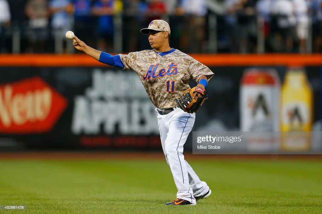 Ruben Tejada #11 of the New York Mets in action against the Philadelphia Phillies on July 28, 2014 at Citi Field in the Flushing neighborhood of the Queens borough of New York City. Mets defeated the Phillies 7-1.