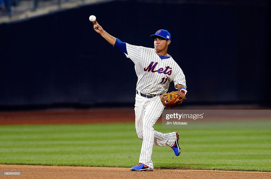 <a gi-track='captionPersonalityLinkClicked' href=/galleries/search?phrase=Ruben+Tejada&family=editorial&specificpeople=5754705 ng-click='$event.stopPropagation()'>Ruben Tejada</a> #11 of the New York Mets in action against the Washington Nationals at Citi Field on September 11, 2013 in the Flushing neighborhood of the Queens borough of New York City. The Nationals defeated the Mets 3-0.