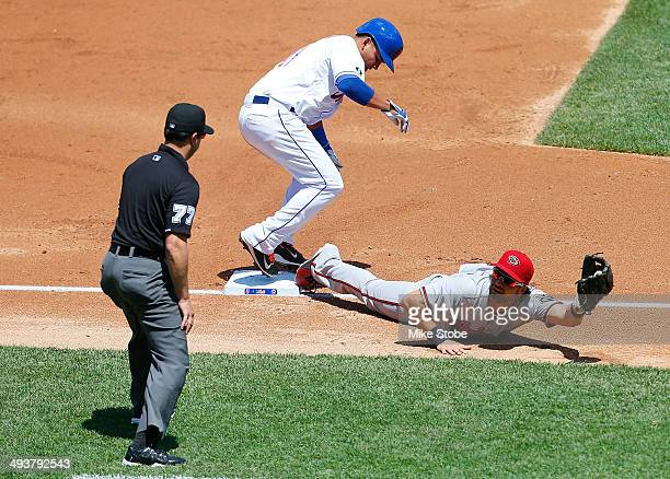 Ruben Tejada of the New York Mets is forced out on a bunt attempt as Eric Chavez of the Arizona Diamondbacks fields the ball in the first inning...