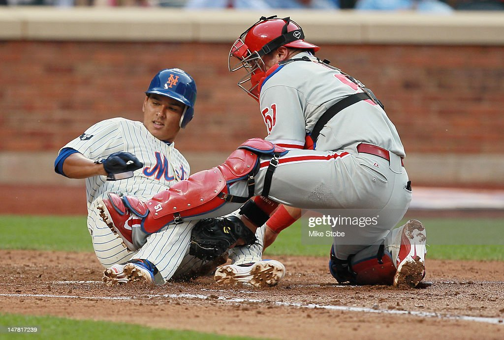 <a gi-track='captionPersonalityLinkClicked' href=/galleries/search?phrase=Ruben+Tejada&family=editorial&specificpeople=5754705 ng-click='$event.stopPropagation()'>Ruben Tejada</a> #11 of the New York Mets is tagged out by Carlos Ruiz #51 of the Philadelphia Phillies at homeplate in the second inning at Citi Field on July 3, 2012 in the Flushing neighborhood of the Queens borough of New York City.