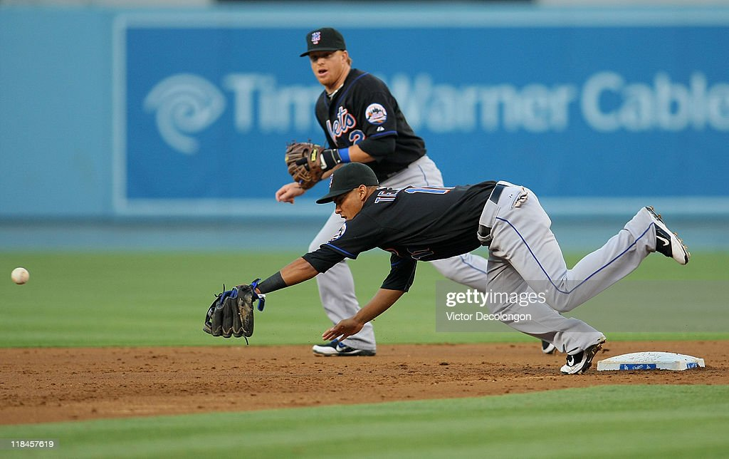 <a gi-track='captionPersonalityLinkClicked' href=/galleries/search?phrase=Ruben+Tejada&family=editorial&specificpeople=5754705 ng-click='$event.stopPropagation()'>Ruben Tejada</a> #11 of the New York Mets misses the catch at second base for the force out on a throw by pitcher Dillon Gee #35 (not in photo) of the Mets in the second inning during the MLB game against the Los Angeles Dodgers at Dodger Stadium on July 7, 2011 in Los Angeles, California.