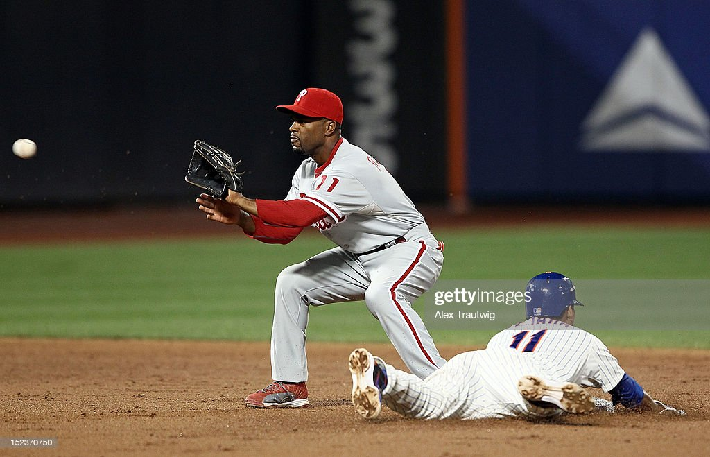 <a gi-track='captionPersonalityLinkClicked' href=/galleries/search?phrase=Ruben+Tejada&family=editorial&specificpeople=5754705 ng-click='$event.stopPropagation()'>Ruben Tejada</a> #11 of the New York Mets slides into second base and beats the throw to <a gi-track='captionPersonalityLinkClicked' href=/galleries/search?phrase=Jimmy+Rollins&family=editorial&specificpeople=204478 ng-click='$event.stopPropagation()'>Jimmy Rollins</a> #11 of the Philadelphia Phillies at Citi Field on September 19, 2012 in the Flushing neighborhood of the Queens borough of New York City.